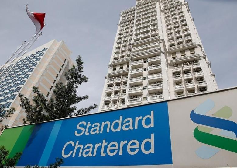 A Standard Chartered sign is seen outside of a building, with a branch of the bank, in Jakarta, Indonesia September 28, 2016. REUTERS/Darren Whiteside