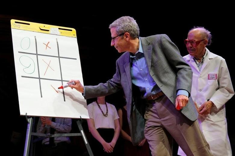 Nobel Laureates Eric Maskin and Dudley Herschbach play ''Tick-Tock-Toe'' during the 26th First Annual Ig Nobel Prize ceremony at Harvard University in Cambridge, Massachusetts, U.S. September 22, 2016.  REUTERS/Brian Snyder