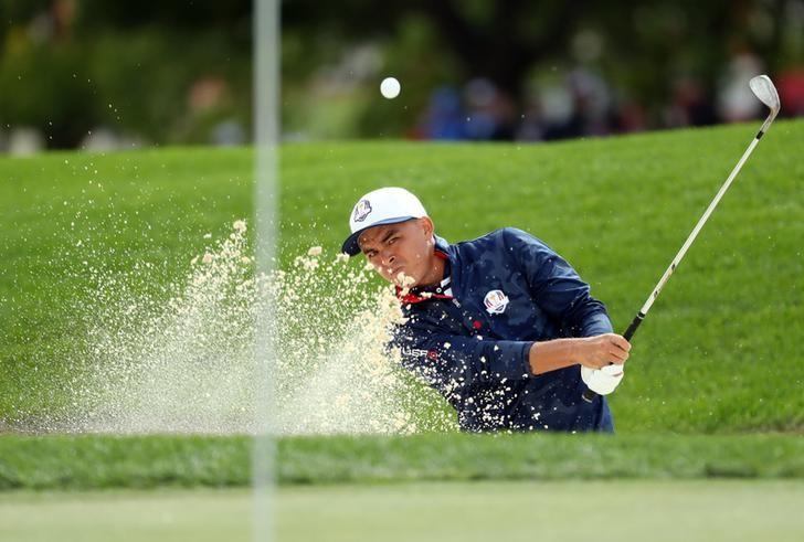 Sep 27, 2016; Chaska, MN, USA;  Rickie Fowler of the United States plays a shot from a bunker on the ninth hole during a practice for the 41st Ryder Cup at Hazeltine National Golf Club. Mandatory Credit: Rob Schumacher-USA TODAY Sports