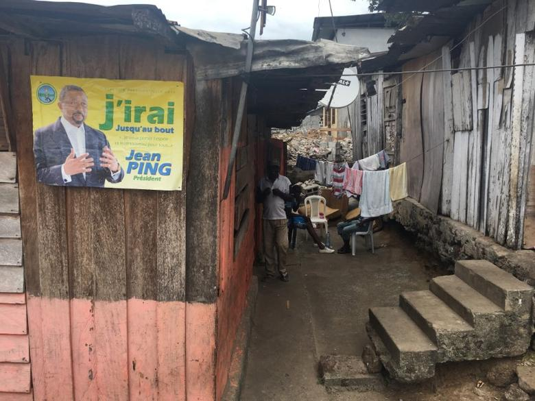 A poster in support of Gabon opposition leader Jean Ping is seen in the Atong Abe neighborhood of Libreville, Gabon, September 25, 2016. REUTERS/Edward McAllister - RTSPCK7