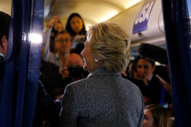 U.S. Democratic presidential nominee Hillary Clinton answers questions from reporters onboard her campaign plane in Chicago, Illinois, U.S. September 29, 2016.  REUTERS/Brian Snyder
