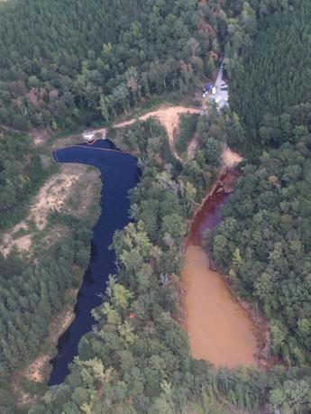 An aerial photo of a man-made mine retention basin Pond 2 (R) and Pond 3 seen in a picture taken September 19, 2016 in Shelby County, Alabama and provided by the Colonial Pipeline Company.  Colonial Pipeline Company/Handout via Reuters