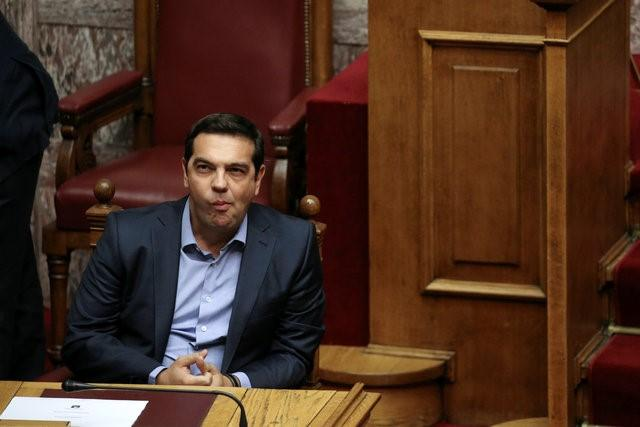 Greek Prime Minister Alexis Tsipras attends a parliamentary session before a vote for an omnibus bill cutting spending on pensions, speed up privatisations and reform the electricity market, in Athens, Greece, September 27, 2016. REUTERS/Alkis Konstantinidis