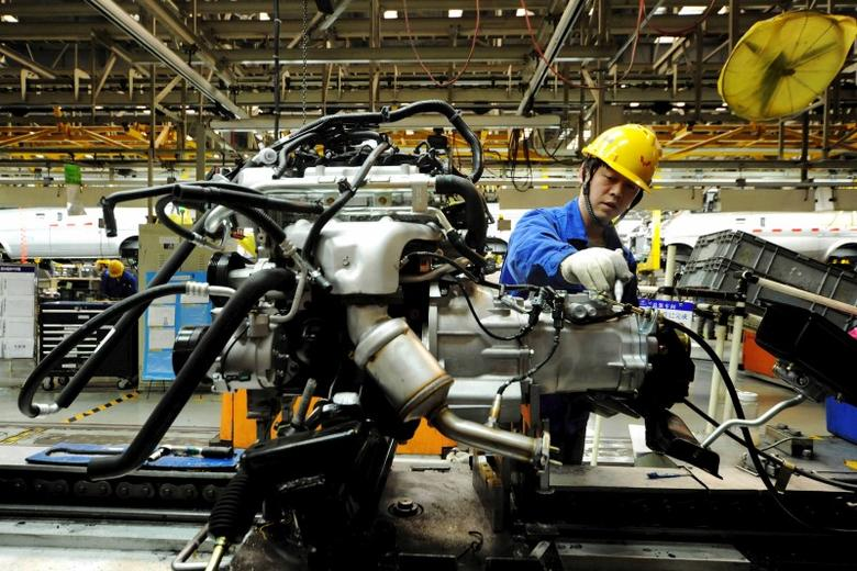 An employee works on an assembly line producing automobiles at a factory in Qingdao, Shandong Province, China, March 1, 2016. REUTERS/Stringer