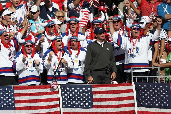Oct 2, 2016; Chaska, MN, USA; Team USA vice-captain Bubba Watson cheers in the stands with fans during the single matches in 41st Ryder Cup at Hazeltine National Golf Club. Mandatory Credit: Rob Schumacher-USA TODAY Sports