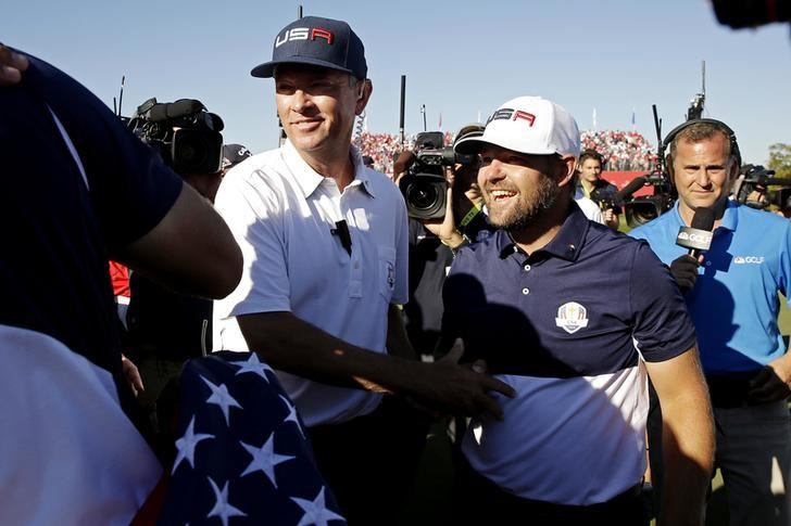 Oct 2, 2016; Chaska, MN, USA; Team USA captain Davis Love III celebrates with  Ryan Moore of the United States after winning the Ryder Cup during the single matches in 41st Ryder Cup at Hazeltine National Golf Club. Mandatory Credit: Rob Schumacher-USA TODAY Sports