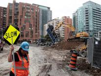 An excavator digs at a condominium construction site on what used to be a neighborhood of single family homes in Toronto, Ontario, Canada October 3, 2016. REUTERS/Chris Helgren