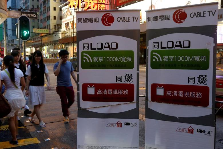 Banners advertising Wharf Holdings' internet business are displayed on a street in Hong Kong June 10, 2016. REUTERS/Bobby Yip/File Photo