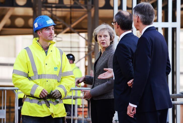 Prime Minister Theresa May (2nd L) and Chancellor of the Exchequer Philip Hammond (R) during a visit to a construction site in Birmingham, where new HSBC offices are being built, Britain October 3, 2016. REUTERS/Stefan Rousseau/Pool