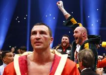 Tyson Fury celebrates after being declared the winner of the fight as Wladimir Klitschko looks dejected. Reuters / Kai Pfaffenbach