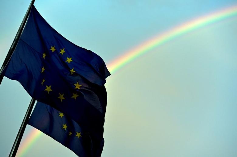 A rainbow is seen behind European flags during a euro zone EU leaders emergency summit on the situation in Greece at the European Council headquarters in Brussels, Belgium, July 7, 2015.    REUTERS/Eric Vidal