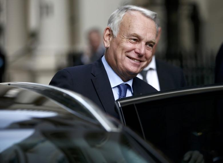 France's Foreign Minister Jean-Marc Ayrault leave 10 Carlton House Terrace in central London, where representatives from Britain, China, France and energy company EDF signed an agreement to build and operate a new nuclear power station at Hinkley Point, Britain, September 29, 2016. REUTERS/Peter Nicholls