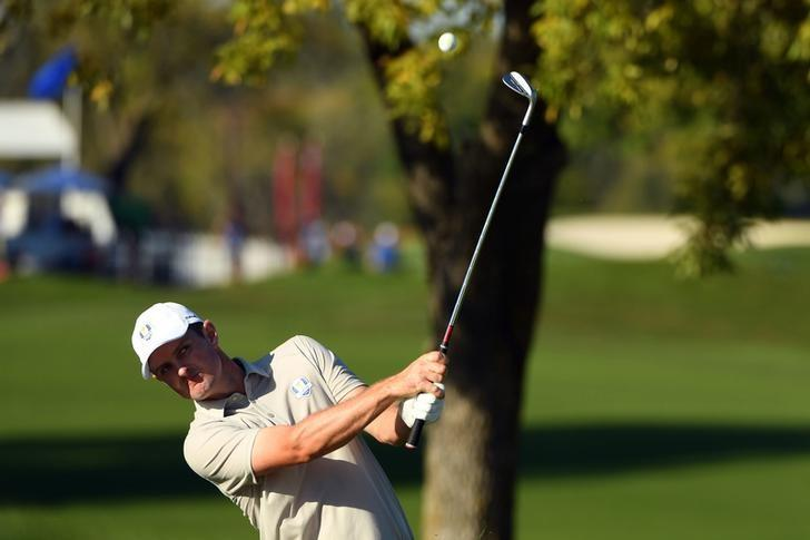 Oct 1, 2016; Chaska, MN, USA;  Justin Rose of England chips on the 11th hole during the afternoon four-ball matches in the 41st Ryder Cup at Hazeltine National Golf Club. Mandatory Credit: John David Mercer-USA TODAY Sports