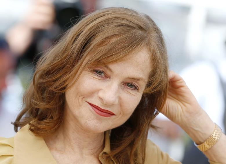 Cast member Isabelle Huppert poses during a photocall for the film ''Elle'' in competition at the 69th Cannes Film Festival in Cannes, France, May 21, 2016.     REUTERS/Yves Herman