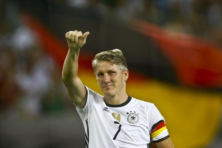 Football Soccer - Germany v Finland - Soccer Friendly - Moenchengladbach, Germany - 31/08/16. Germany's Bastian Schweinsteiger reacts after the match.      REUTERS/Wolfgang Rattay