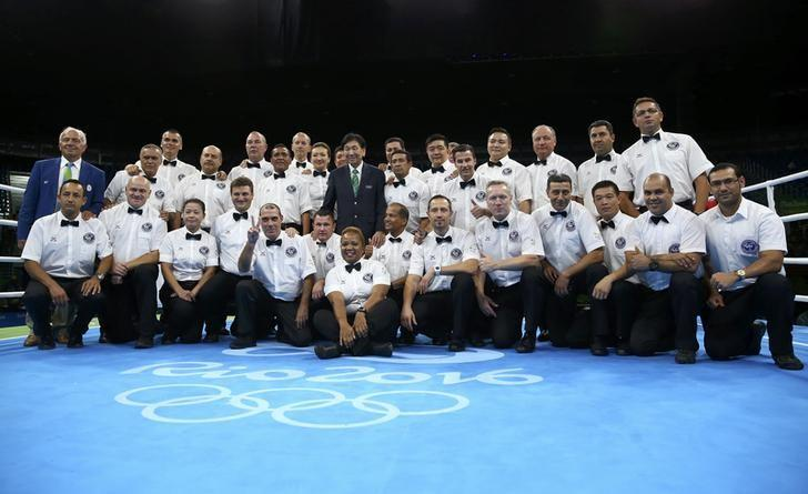 AIBA President Ching-Kuo Wu (C) takes a photo with boxing officials at Riocentro Pavilion 6 in Rio de Janeiro, Brazil, during the 2016 Rio Olympics August 21, 2016. REUTERS/Peter Cziborra/Files