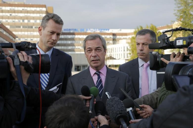 Nigel Farage (C), United Kingdom Independence Party (UKIP) member and MEP, talks to journalists as he leaves the Hautepierre Hospital in Strasbourg, France, October 6, 2016 where Steven Woolfe, of the United Kingdom Independence Party (UKIP), was in, after suffering ''epileptic-like'' seizures on Thursday following an ''altercation'' at a heated European Parliament meeting on the party's future.  REUTERS/Vincent Kessler