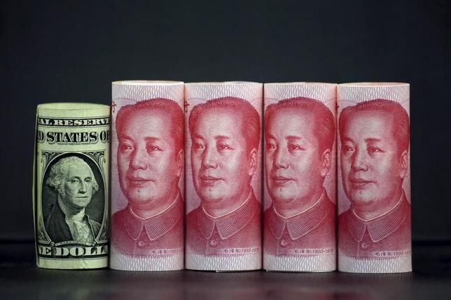 10月7日、オフショア(中国本土外)市場の人民元が7日序盤の取引で対米ドルで下落。6.7182元と1月7日以来、9カ月ぶり低水準をつけた。写真は北京で1月撮影(2016年 ロイター/Jason Lee)