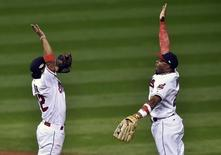 Cleveland Indians shortstop Francisco Lindor (12) celebrates with center fielder Rajai Davis (20) the 5-3 victory against the Boston Red Sox following game one of the 2016 ALDS playoff baseball game at Progressive Field. Mandatory Credit: David Richard-USA TODAY Sports