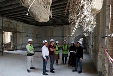 Afghan engineers discuss inside the ruined Darul Aman palace in Kabul, Afghanistan October 2, 2016. Picture taken October 2, 2016. REUTERS/Mohammad Ismail