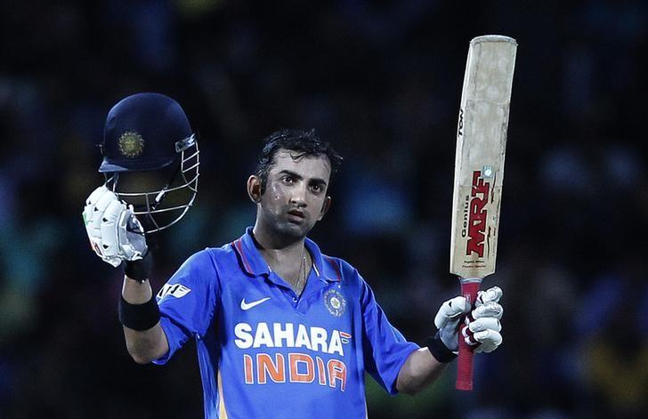 India's Gautam Gambhir celebrates after scoring a century during the third One-Day International cricket match against Sri Lanka in Colombo, July 28, 2012.    REUTERS/Dinuka Liyanawatte/Files