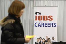 A woman walks through the 2014 Spring National Job Fair and Training Expo in Toronto, April 3, 2014. REUTERS/Aaron Harris/File Photo