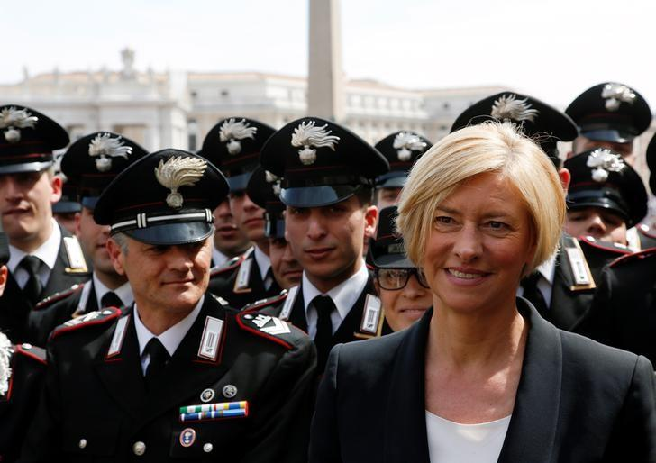 Italy's Defence Minister Roberta Pinotti (R) smiles at the end of a mass for the Armed Forces Jubilee led by Pope Francis in Saint Peter's Square at the Vatican, April 30, 2016. REUTERS/Alessandro Bianchi/Files
