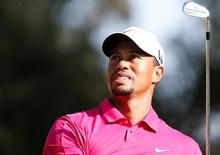 Tiger Woods of the U.S. tees off on the eighth hole during the third round of the inaugural Turkish Airlines Open in the southwest city of Antalya November 9, 2013. REUTERS/Umit Bektas/File Photo