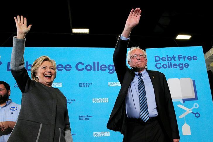 U.S. Democratic presidential nominee Hillary Clinton and U.S. Senator Bernie Sanders take the stage to talk about college affordability during a campaign event at the University of New Hampshire in Durham, New Hampshire, United States September 28, 2016.  REUTERS/Brian Snyder