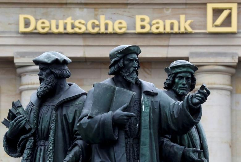 A statue is pictured next to the logo of Germany's Deutsche Bank in Frankfurt, Germany September 30, 2016. REUTERS/Kai Pfaffenbach/File Photo