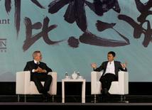 Steven Spielberg (L), film director and chairman of Amblin Partners and Jack Ma, chairman and chief executive of Alibaba Group, attend an event to announce partnership between Alibaba Pictures Group Limited and Amblin Partners, in Beijing, China, October 9, 2016. REUTERS/Shirley Feng