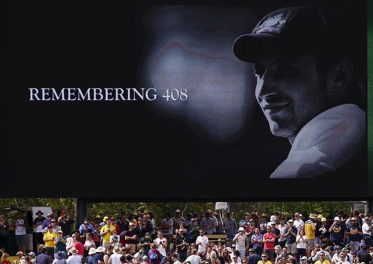 A tribute to former Australian cricketer Phillip Hughes, who was the 408th player for Australia, is displayed on a screen during the first day of the third cricket test match between Australia and New Zealand at the Adelaide Oval in South Australia, November 27, 2015.   REUTERS/David Gray/File Photo