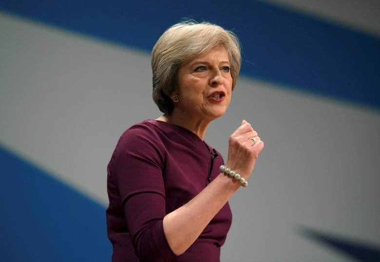 Britain's Prime Minister Theresa May gives her speech on the final day of the annual Conservative Party Conference in Birmingham, Britain, October 5, 2016.      REUTERS/Toby Melville/File Photo