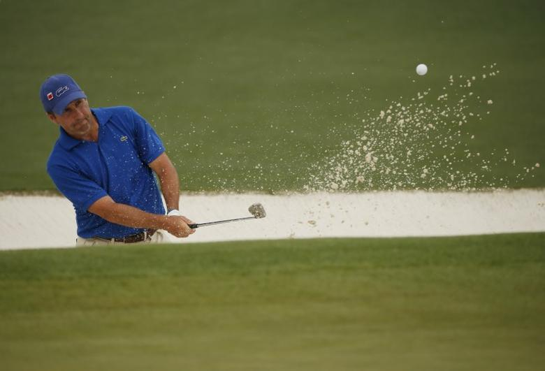 Jose Maria Olazabal of Spain chips from a sand trap onto the second green during second round play of the Masters golf tournament at the Augusta National Golf Course in Augusta, Georgia April 10, 2015.  REUTERS/Phil Noble