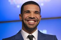 Rapper Drake smiles during an announcement that the Toronto Raptors will host the NBA All-Star game in Toronto, September 30, 2013.   REUTERS/Mark Blinch/File Photo