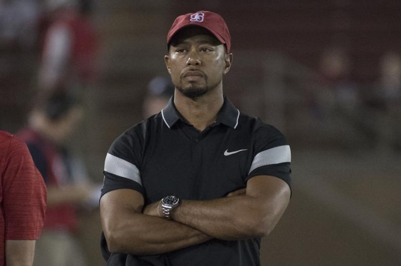 October 8, 2016; Stanford, CA, USA; Tiger Woods watches before the game between the Stanford Cardinal and the Washington State Cougars at Stanford Stadium. Mandatory Credit: Kyle Terada-USA TODAY Sports