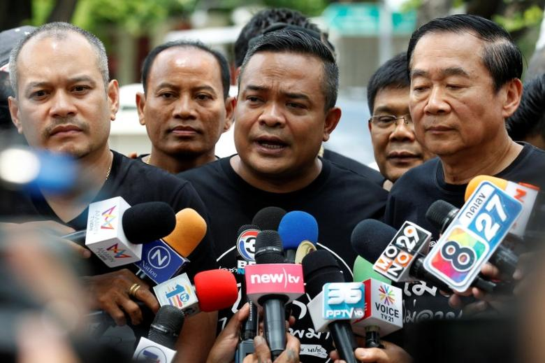 Red shirt leader Jatuporn Prompan speaks with members of Thai media as he arrives at the United Nations building in Bangkok, Thailand, June 20, 2016. REUTERS/Chaiwat Subprasom