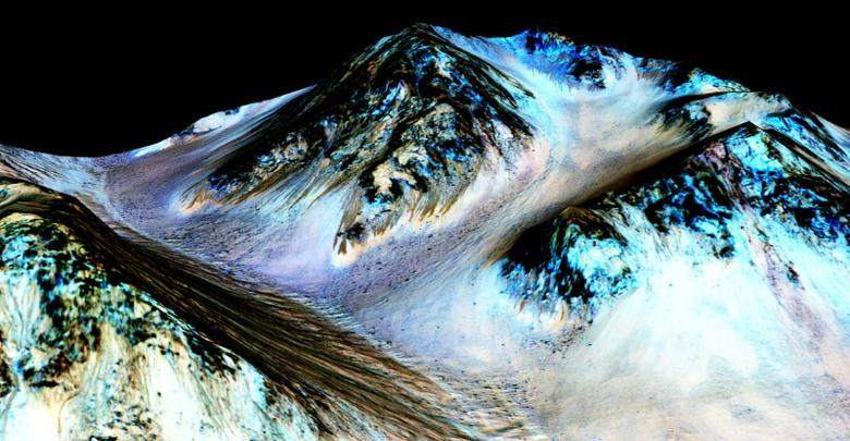 Dark, narrow, 100 meter-long streaks on Mars inferred to have been formed by contemporary flowing water are seen in an image produced by NASA, the Jet Propulsion Laboratory (JPL) and the University of Arizona. Scientists have found the first evidence that briny water may flow on the surface of Mars during the planet's summer months, a paper published on Monday showed.  NASA/JPL/University of Arizona/Handout