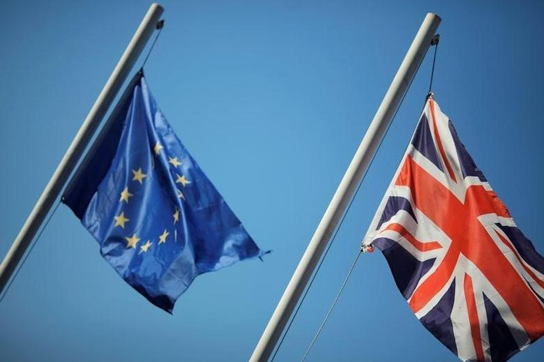 The Union Jack (R) and the European Union flag are seen flying outside The Rock hotel in the British Colony of Gibraltar, May 19, 2016. REUTERS/Jon Nazca/Files