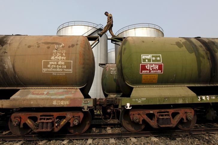 A worker walks atop a tanker wagon to check the freight level at an oil terminal on the outskirts of Kolkata, India in this November 27, 2013 file photo.    REUTERS/Rupak De Chowdhuri/Files