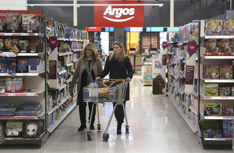 Shoppers pass an Argos concession at a Sainsbury's store in London, Britain October 11, 2016. REUTERS/Neil Hall