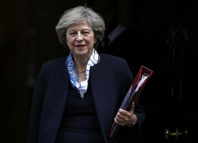 10月12日、メイ英首相(写真)は、欧州連合(EU)離脱のプロセスについて、議員による一定の精査を認める方針を示した。(2016年 ロイター/Peter Nicholls)