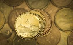 """A Canadian dollar coin, commonly known as the """"Loonie"""", is pictured in this illustration picture taken in Toronto January 23, 2015. The Canadian dollar strengthened against the U.S. dollar on Friday after Canadian CPI data showed an increase in core inflation.   REUTERS/Mark Blinch"""