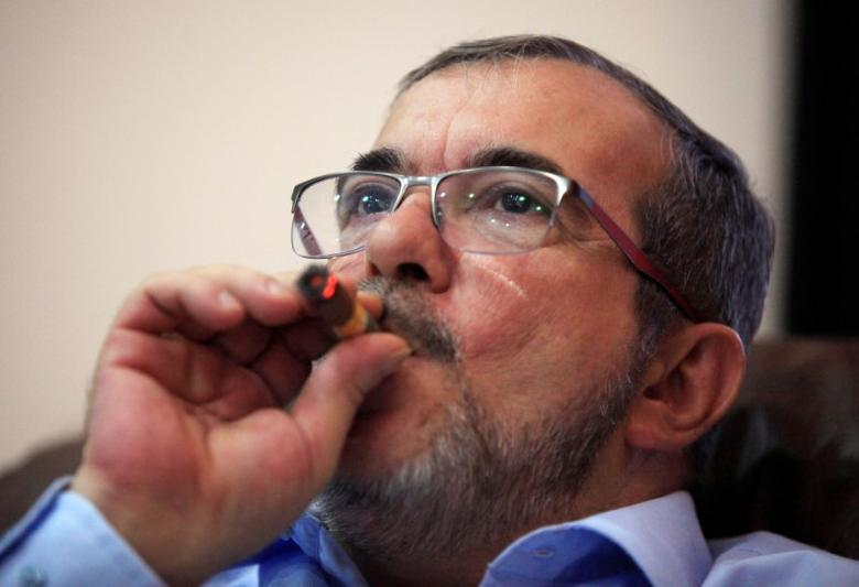 Revolutionary Armed Forces of Colombia (FARC) rebel leader Rodrigo Londono smokes a Cohiba cigar while watching a live transmission of the referendum on a peace deal, in Havana, Cuba October 2, 2016. REUTERS/Enrique de la Osa