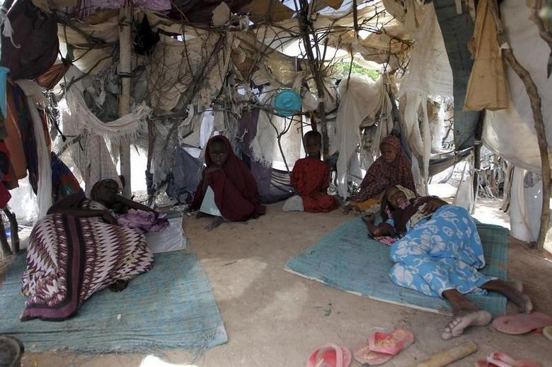 A Somali refugee family is pictured inside their makeshift shelter at the Ifo camp in Dadaab near the Kenya-Somalia border, May 8, 2015.  REUTERS/Thomas Mukoya