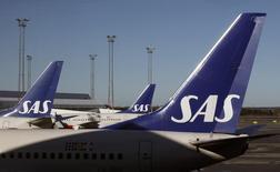 La Suède et la Norvège se désengagent partiellement de SAS. Les deux pays avaient cédé 23 millions d'actions dans la compagnie aérienne scandinave. La Suède reste le principal actionnaire de SAS avec 17,2% des parts, contre 11,5% pour la Norvège. /Photo d'archives/ REUTERS/Bob Strong