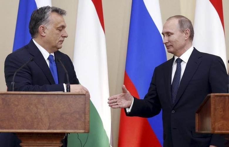Russian President Vladimir Putin (R) and Hungarian Prime Minister Viktor Orban shake hands during a joint news conference following their talks at the Novo-Ogaryovo state residence outside Moscow, Russia, February 17, 2016. REUTERS/Maxim Shipenkov