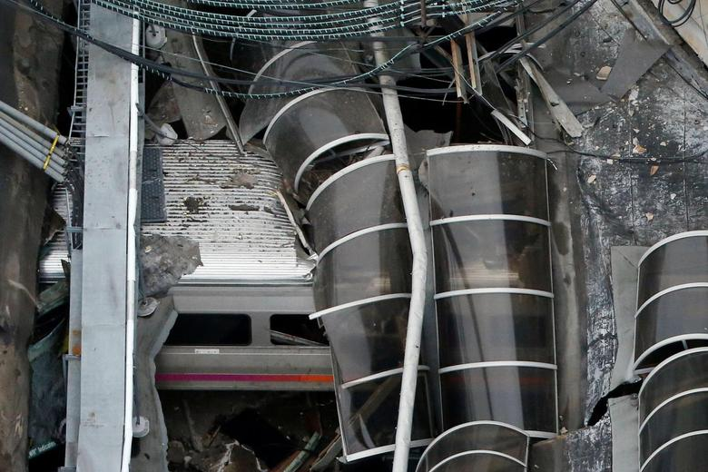 A train car is pictured in an aerial photo inside the New Jersey Transit Hoboken Terminal following a train crash in Hoboken, New Jersey, U.S. on September 29, 2016. REUTERS/Carlo Allegri/File Photo
