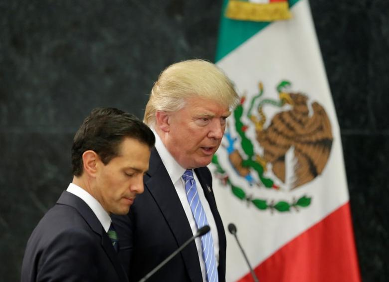 U.S. Republican presidential nominee Donald Trump and Mexico's President Enrique Pena Nieto arrive for a press conference at the Los Pinos residence in Mexico City, Mexico, August 31, 2016. REUTERS/Henry Romero