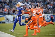 Oct 13, 2016; San Diego, CA, USA; San Diego Chargers quarterback Philip Rivers (17) runs out of bounds as he is pressured by the Denver Broncos defense during the first half at Qualcomm Stadium. Mandatory Credit: Orlando Ramirez-USA TODAY Sports